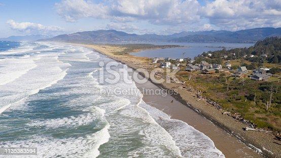 Driftwood lines the beach at Cape Meares Oregon near Bayocean Peninsula Park