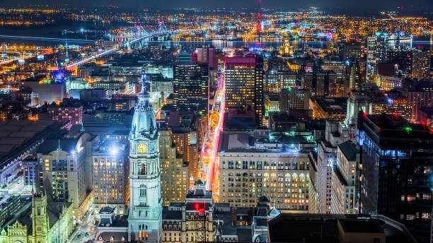 aerial philadelphia cityscape by night - philadelphia skyline stock photos and pictures