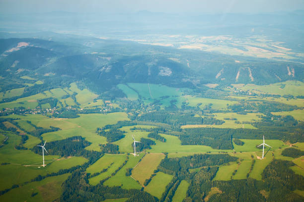 Aerial photo of beautiful landscape with meadows, forests and fields with wind turbines stock photo