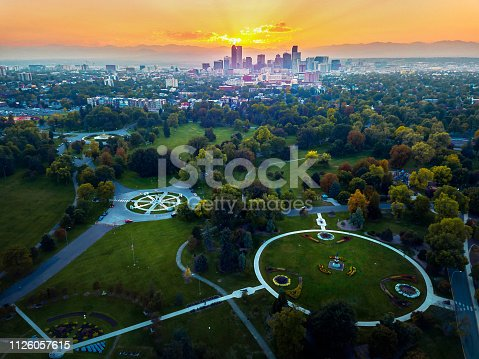 Aerial photo of Denver skyline at sunset taken from a park
