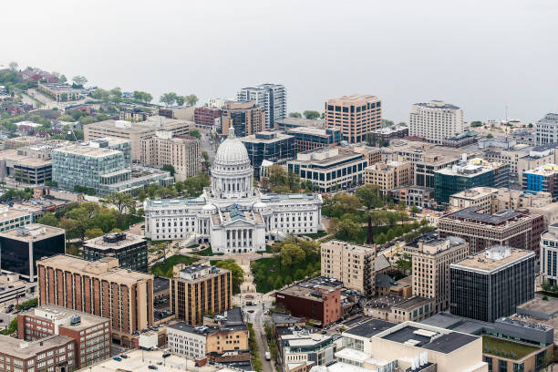 Aerial photo of downtown Madison, Wis. and the Wisconsin State Capitol. An aerial photo of downtown Madison and the Wisconsin State Capitol taken from an airplane. madison wisconsin stock pictures, royalty-free photos & images