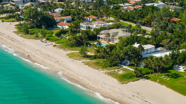 Aerial photo of luxury beachfront mansions in South Florida Aerial Miami luxury waterfront homes promenade stock pictures, royalty-free photos & images