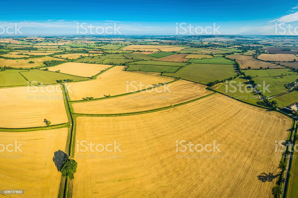 Aerial photo of rural crop fields green pasture idyllic countryside stock photo