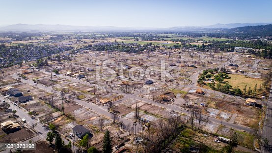 Drone photo shows fire damage in the Coffey Park neighborhood eight months after a massive fire destroyed the neighborhood. Only a handful of homes have been rebuilt.