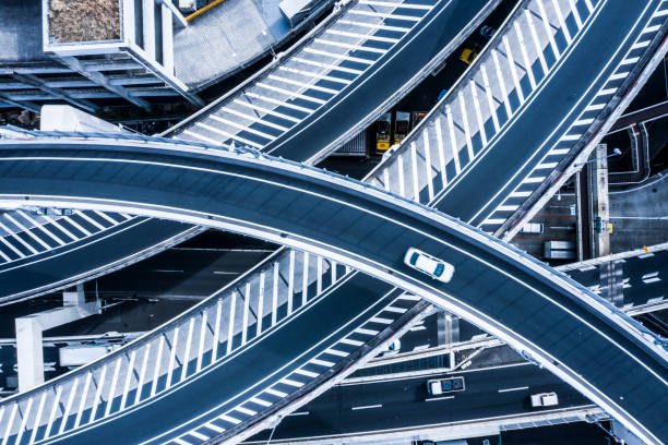 Aerial photograph of beautifully curved highway. Multi-level crossing. Viewpoint from directly above. overpass road stock pictures, royalty-free photos & images