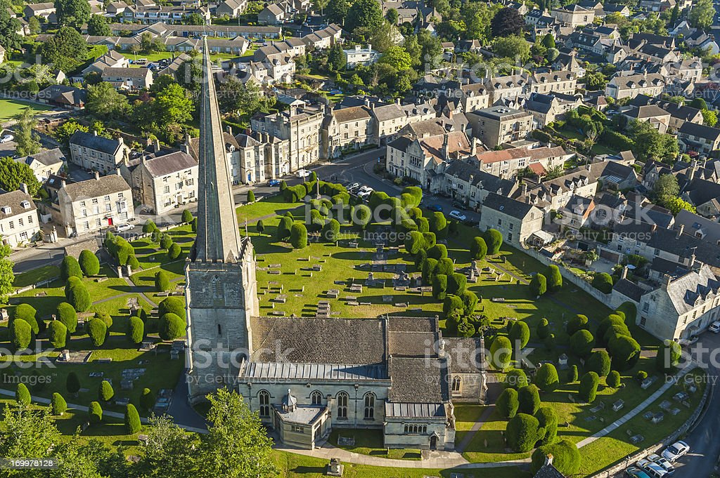 Aerial photograph of idyllic English village Cotswold church summer UK stock photo