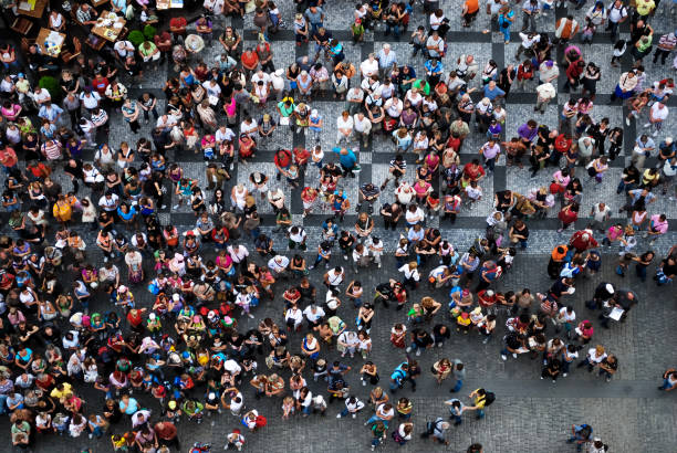 aerial photograph of people gathered in a square - people stock pictures, royalty-free photos & images