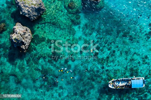 istock Aerial photograph of the beautiful sea and divers. 1078386004