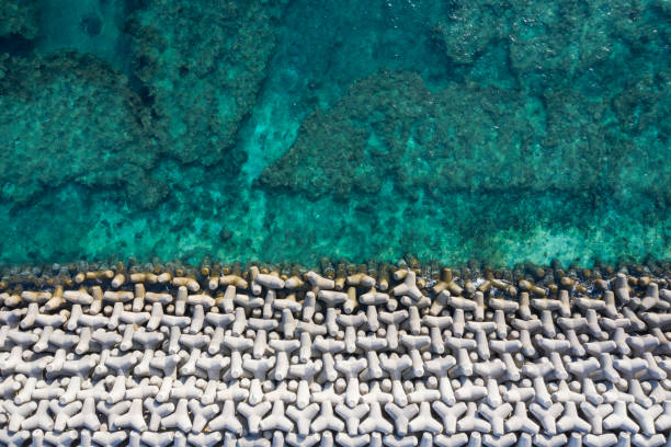 Aerial photograph of the beautiful sea and tetrapod. A beautiful ocean with a sense of transparency. Tetrapod.Viewpoint from directly above. groyne stock pictures, royalty-free photos & images