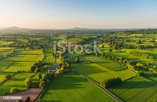 istock Aerial photograph rural landscape farms villages picturesque green patchwork pasture 1292399669