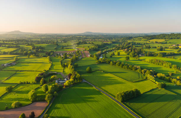 Aerial photograph rural landscape farms villages picturesque green patchwork pasture stock photo