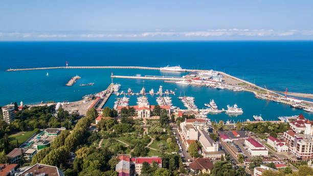 Aerial photography. Panoramic view of the sea port of Sochi on a clear day. Blue sky. Yachts and boats are berthed. Attraction of the resort city. Aerial photography. Panoramic view of the sea port of Sochi on a clear day. Blue sky. Yachts and boats are berthed. Attraction of the resort city. sochi stock pictures, royalty-free photos & images