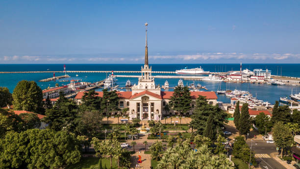 Aerial photography. Sea port with a bird's-eye view on a Sunny day. Yachts and boats are berthed. Promenade. Attraction of the city of Sochi. Ship Prince Vladimir in port. Aerial photography. Sea port with a bird's-eye view on a Sunny day. Yachts and boats are berthed. Promenade. Attraction of the city of Sochi. Ship Prince Vladimir in port. sochi stock pictures, royalty-free photos & images