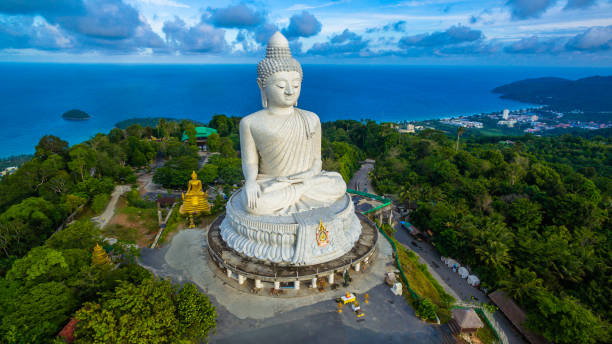 aerial photography white great phuket's big buddha in blue sky. - phuket stock photos and pictures