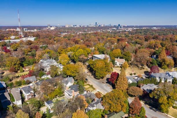 Aerial picture of houses in Midtown Atlanta during the fall with Buckhead buildings in the background stock photo