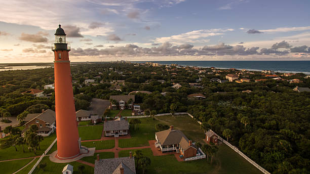 Aerial picture of lighthouse during sunset on Florida beach stock photo
