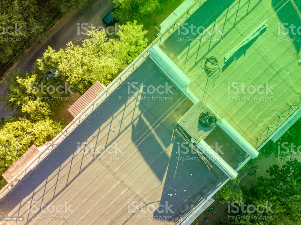 aerial roof overhead view, building between the trees zbiór zdjęć royalty-free