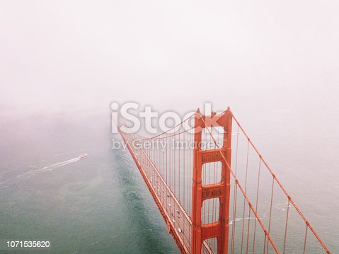 Gorgeous aerial scene of the San Francisco Golden Gate bridge from above over the Pacific ocean golden gate canal near Alcatraz island.
