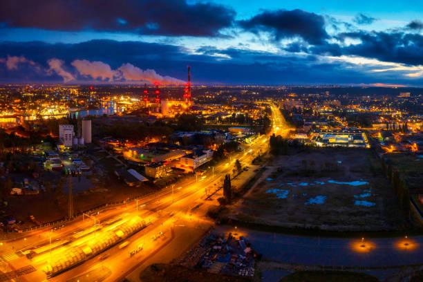 aerial scenery of harbor area in gdansk at dusk - drone shipyard night imagens e fotografias de stock