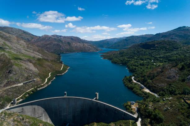 aerial scenic view of the vilarinho das furnas dam at the peneda geres national park - barragem portugal imagens e fotografias de stock