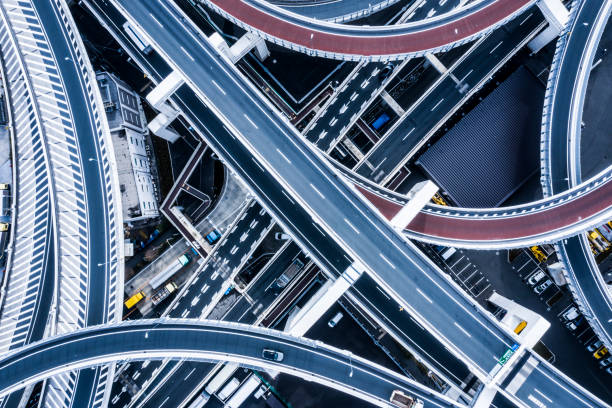 Aerial shooting in the junction area.A highway in Japan. The elevated road intersects. elevated road stock pictures, royalty-free photos & images