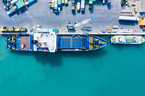 Aerial shooting in the logistics area. Container ship to anchor.
