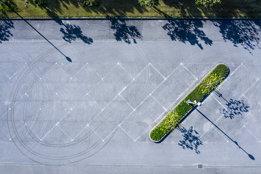 Aerial shooting of a parking lot with nobody.