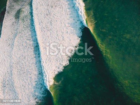 843079528istockphoto Aerial shooting of big stormy waves at sunset. Biggest ocean wave 1011061806