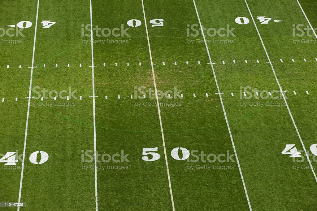 Aerial shot af a grass American football field stock photo