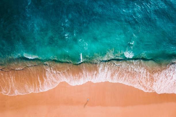 aerial shot of a beach - riva dell'acqua foto e immagini stock
