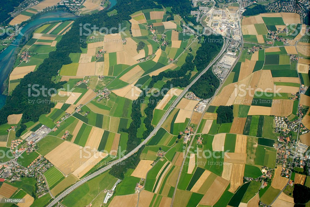Aerial shot of a landscape with different shades of green royalty-free stock photo