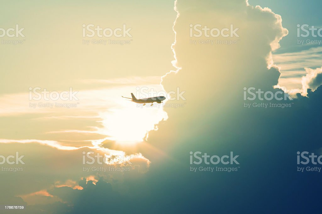 Aerial shot of a plane flying in the sky amidst the clouds royalty-free stock photo