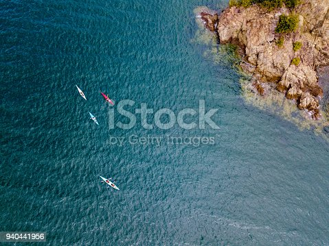 istock Aerial shot of a small group of people sea kayaking 940441956
