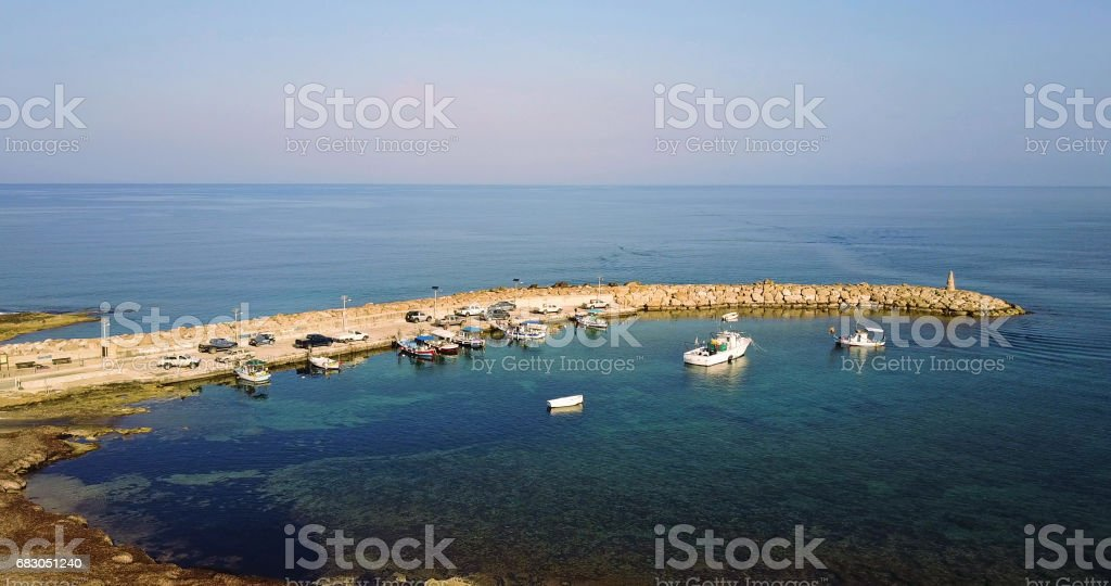 Aerial Shot of beautiful bay with yachts fly away royalty-free stock photo