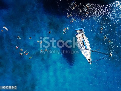 istock Aerial shot of beautiful blue lagoon at hot summer day with sail 924038340