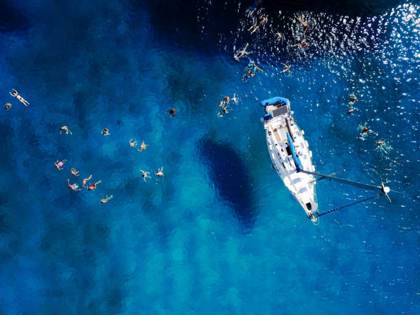 aerial shot of beautiful blue lagoon at hot summer day with sail - sail stock pictures, royalty-free photos & images