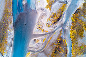 Abstract pattern of braided Hvita River from above in South Central Iceland.