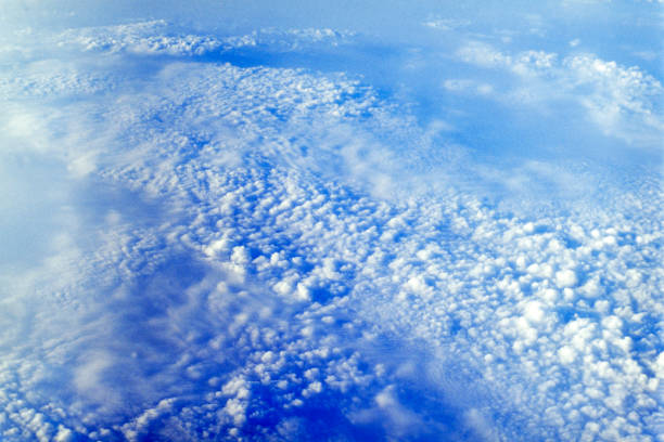 aerial shot of clouds from above the skies of south china sea stock photo