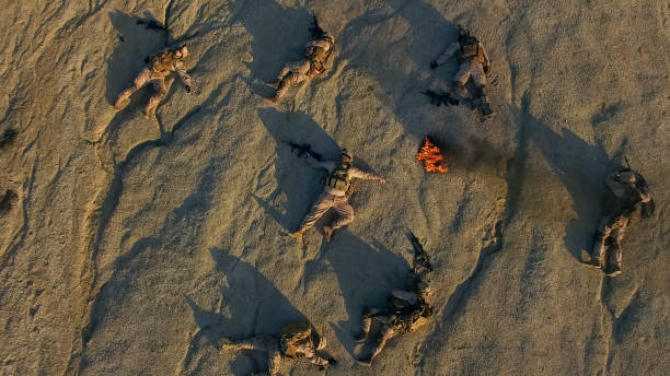Aerial Shot of Group of Dead Soldiers in Desert Area. stock photo