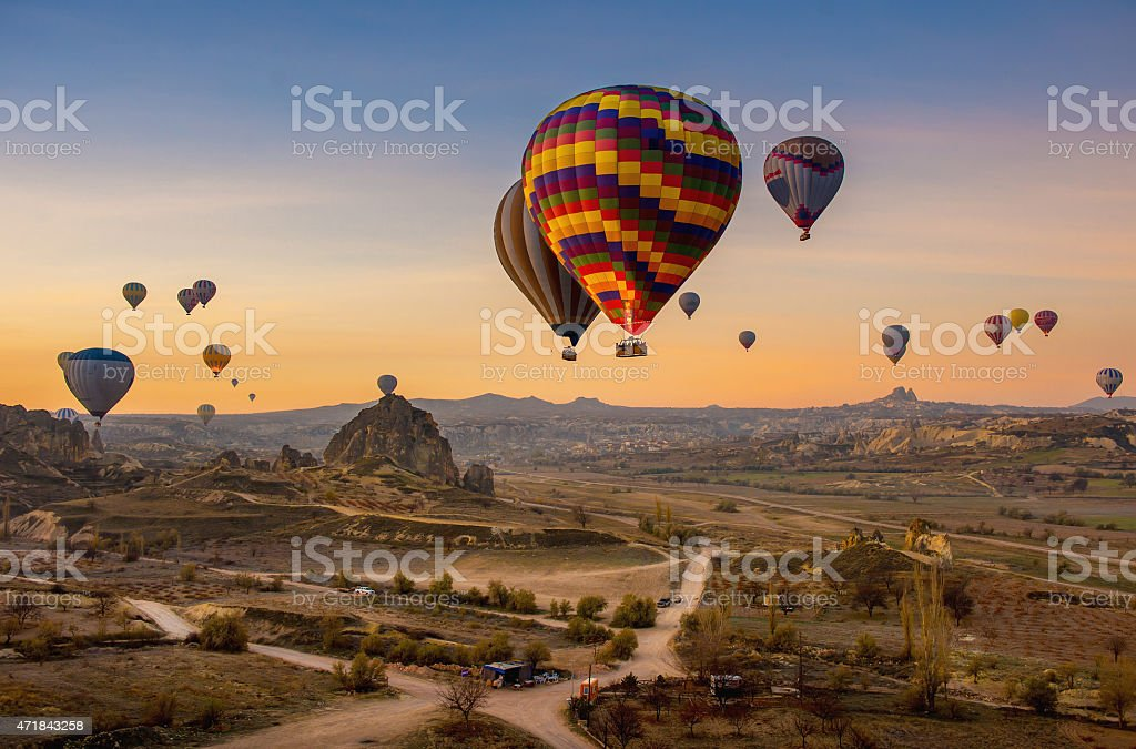 Aerial shot of hot air balloons floating in the sky at dusk stock photo