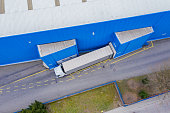 Aerial Shot of Industrial Warehouse/ Storage Building/ Loading