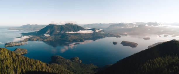 Aerial shot of islands near Tofino, Canada while sunrise Summer sunrise from Lone Cone vancouver island stock pictures, royalty-free photos & images