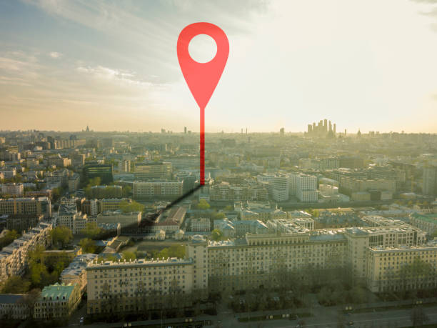 aerial shot of marker pointing on the streets of europe city during sunset b aerial shot of marker pointing on the streets of europe city during sunset global positioning system stock pictures, royalty-free photos & images