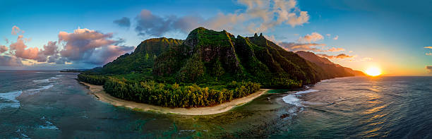 aerial shot of napali coast at sunset (kauai, hawaii) - pacific islands stock pictures, royalty-free photos & images