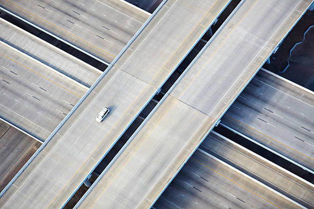 Aerial shot of one car on freeway  multiple lane highway stock pictures, royalty-free photos & images