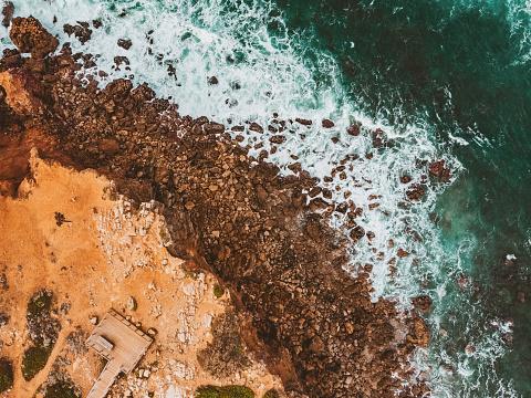 Aerial Shot of Praia da Bordeira, Algarve, Portugal – amazing rocky coastline
