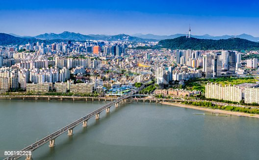 istock Aerial shot of Seoul City Skyline and N Seoul Tower with traffic bridge, South Korea. 806192228