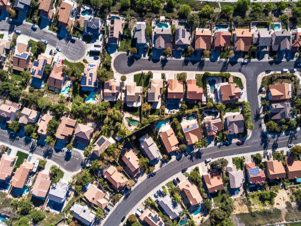 Aerial Shot of Suburban Development Top down aerial shot of suburban tract housing near Santa Clarita, California. A maze of roads and dead end streets of large single family homes, some with swimming pool. drone point of view stock pictures, royalty-free photos & images