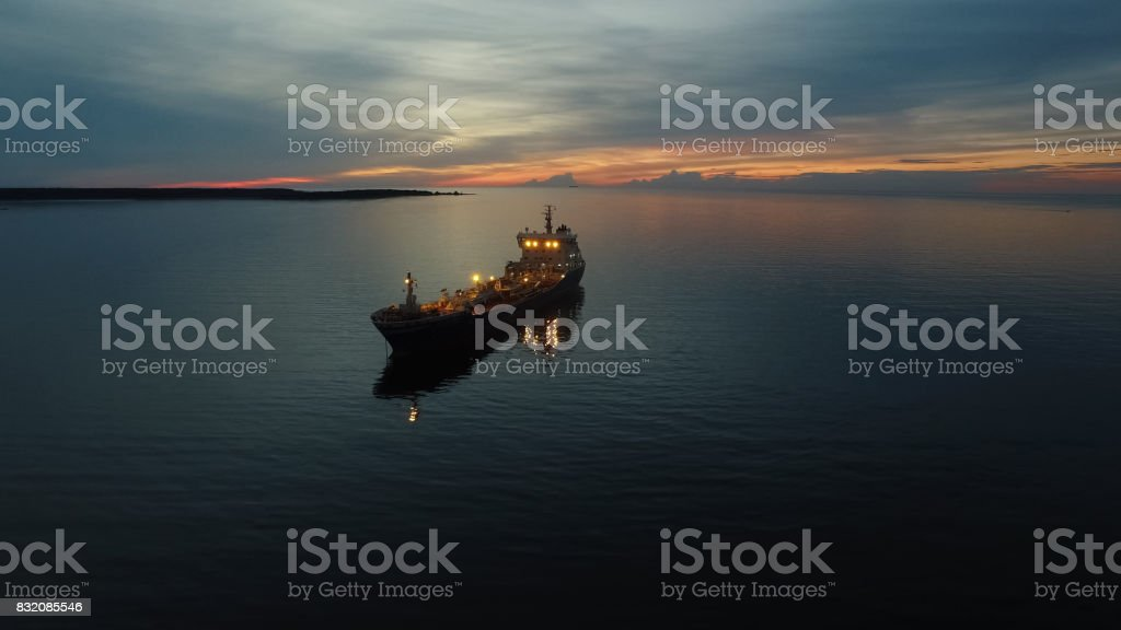 Aerial Shot of Tanker Ship Moving in Sea at Night stock photo