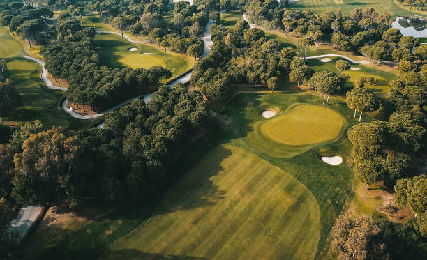 Aerial shot of the golf course Golf Course, Green - Golf Course, Sand Trap, Playing Field green golf course stock pictures, royalty-free photos & images